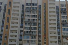 г. Заречный работа над фасадом многоквартирного дома